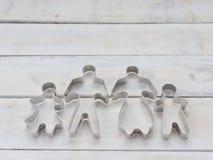 Form för deg för snittet för skäraren för det familjmetallkakan eller kexet komponerade van vid i synnerhet av fader, moder, brod Royaltyfria Foton