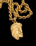 form för hänge för christ framsidaguld Royaltyfri Foto