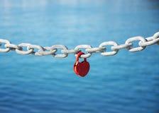 form för hjärtalåspadlock Royaltyfri Foto