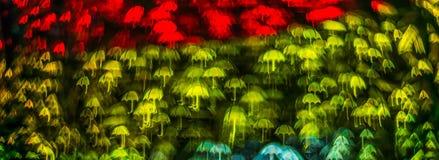 Form för paraplyet för nattljusbokeh, defocused bokeh tänder, blurr Royaltyfri Bild