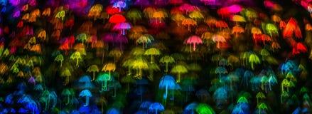 Form för paraplyet för nattljusbokeh, defocused bokeh tänder, blurr Arkivbild