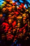 Form för paraplyet för nattljusbokeh, defocused bokeh tänder, blurr Arkivbilder