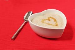 form för red för porridge för bakgrundsbunkehjärta Arkivfoton