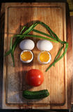 A form of food. Vegetables and egg in form of funny face Stock Image