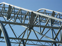 Form and Function. Flexible steel roof structure illustrating strength of triangles stock images