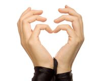 The form of heart shaped by female hands. Stock Photography