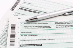 Form of income tax return with pen Stock Photography