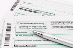 Form of income tax return with pen Stock Image