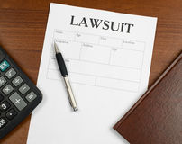 The form of the lawsuit is on the table Royalty Free Stock Image