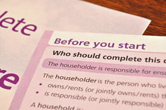 Form and leaflet. Filling a form or a questionaire and a leaflet Stock Image