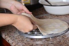 Form milking pelmeni, put dough Stock Photo