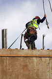 Form Raising. Worker atop a large form for a concrete wall royalty free stock photography