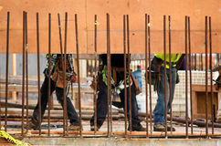 Form Raising. Workmen assembling a large form for a concrete wall royalty free stock image
