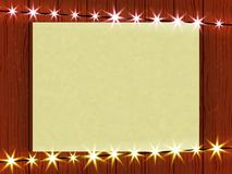 Form for your business, on a wooden wall and a sheet of paper garland, and sparkling lights. Illustration Stock Photo