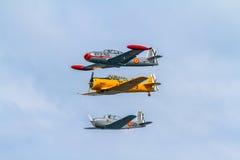Formação de três aviões do FIO Imagem de Stock