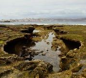 Formação rochosa singular na maré baixa Foto de Stock