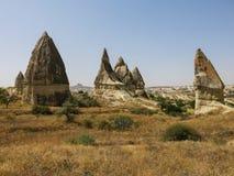 Formações de rocha dramáticas na região de Cappadocia de Turquia Fotografia de Stock Royalty Free
