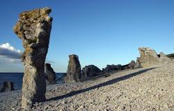 Formações e mar de rocha Fotos de Stock Royalty Free