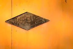 Forma abstracta del metal en la hoja anaranjada Imagenes de archivo