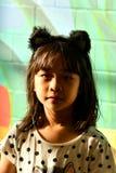 Forma adolescente amarela asiática imagem de stock