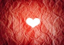 Forma bianca del cuore su fondo di carta vibrante Immagine Stock
