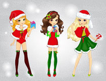 Forma bonita Santa Girls Holding Presents Fotos de Stock