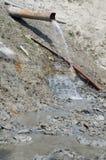 Forma corriente del agua la tubería Foto de archivo libre de regalías