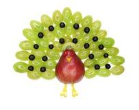 Forma creativa del pavo real del postre del niño de la fruta Imagen de archivo libre de regalías