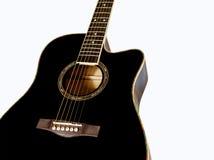 Forma da guitarra acústica no preto Fotografia de Stock