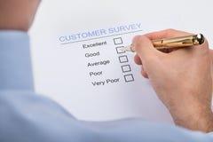 Forma de la encuesta sobre Marking On Customer del empresario Imagenes de archivo