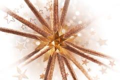 Forma de oro de la estrella que estalla Imagenes de archivo