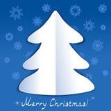 Forma del árbol de navidad en un fondo azul con sno Foto de archivo libre de regalías