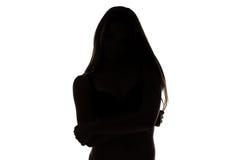 Forma del adolescente con los brazos cruzados Imagen de archivo