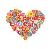 Forma del corazón con las flores coloridas y hippie simbólico Imágenes de archivo libres de regalías