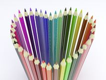 Forma del corazón con los lápices coloreados Fotografía de archivo libre de regalías