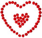 Forma del corazón de bolas rojas Fotos de archivo libres de regalías