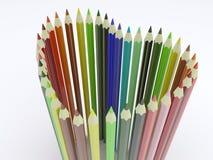 Forma del cuore con le matite colorate Fotografie Stock Libere da Diritti