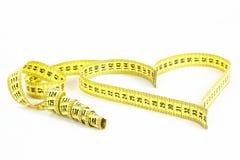 Forma del cuore di misura di nastro - salute, concetto del peso Fotografie Stock Libere da Diritti