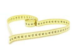 Forma del cuore di misura di nastro - salute, concetto del peso Immagini Stock