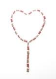 Forma del cuore di San Valentino fatta della caramella gommosa e molle rosa e bianca immagini stock libere da diritti