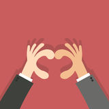 Forma del cuore fatta con la mano di affari delle mani Immagini Stock