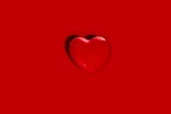 Forma del cuore su rosso Immagini Stock Libere da Diritti