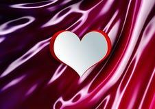Forma del cuore su seta Immagini Stock