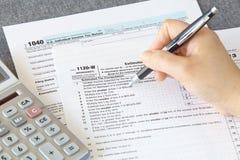 Forma del impuesto sobre la renta de U S Foto de archivo