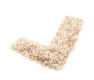 Forma del segno di spunta fatta dei fiocchi della farina d'avena Fotografia Stock