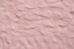 Forma di Wave rosa del modello del muro di cemento Parete rosa astratta del cemento fotografia stock
