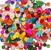 Forma differente e colori che cucono il fondo dei bottoni T variopinta fotografia stock