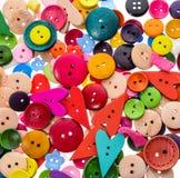 Forma differente e colori che cucono il fondo dei bottoni T variopinta Immagine Stock