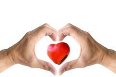 Forma do coração com o símbolo da mão Fotos de Stock Royalty Free
