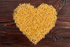 Forma do coração da massa italiana do stelline Foto de Stock